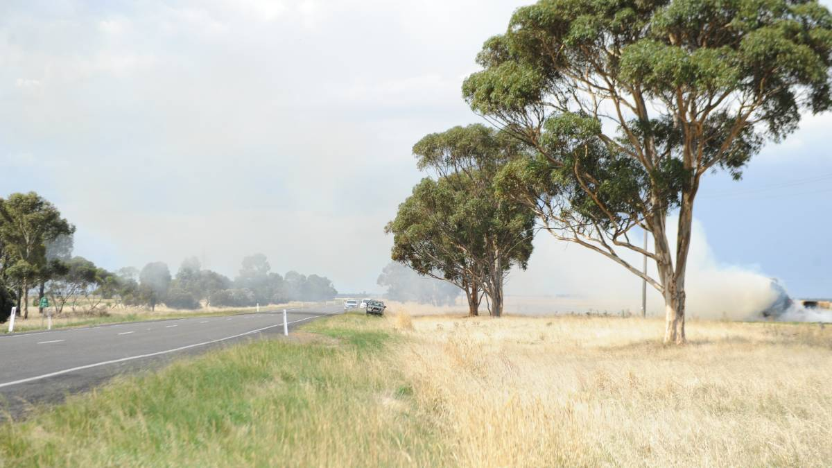 SMOKY: A haystack fire in a paddock near the Henty Highway at Jung. Picture: ALEXANDER DARLING