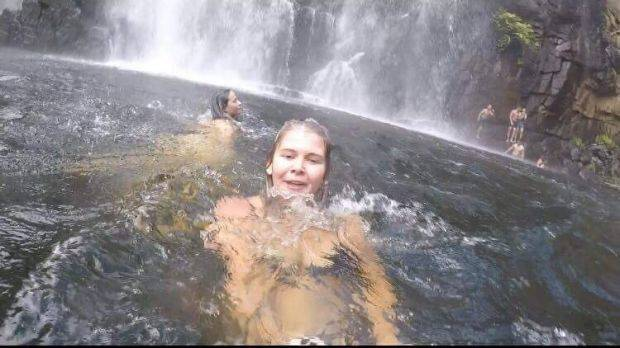 Anneka Bading films herself swimming near MacKenzie Falls, unaware a man has just slipped into the water. In the background his friends are frantically trying to rescue him. Photo: Anneka Bading